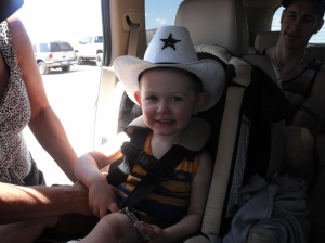 Raising him right. The cowboy hat is perfect.