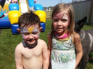 Auntie Jess doing the face painting as super heros.