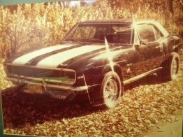 My 1967 Camaro RS/SS Black, white striping,front rotor brakes,rear folding seat, 12 bolt posi rare rare factory options.