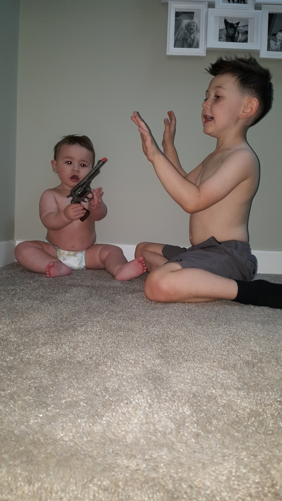 These kids are cute !!! August and Jackson playing cops and robbers
