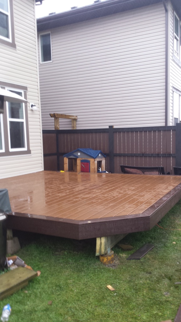 A wonderful looking deck just missing the stairs and railings