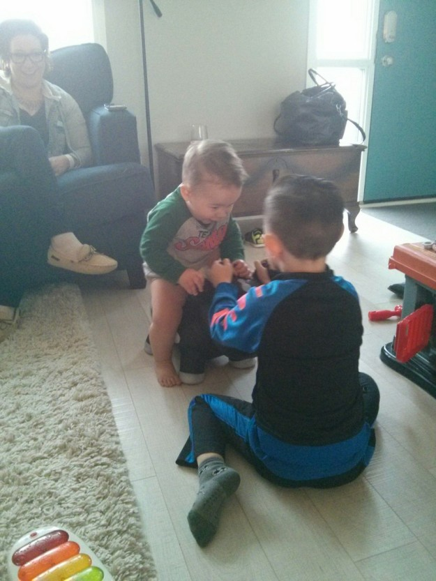 Jackson and August playing ride the cow.