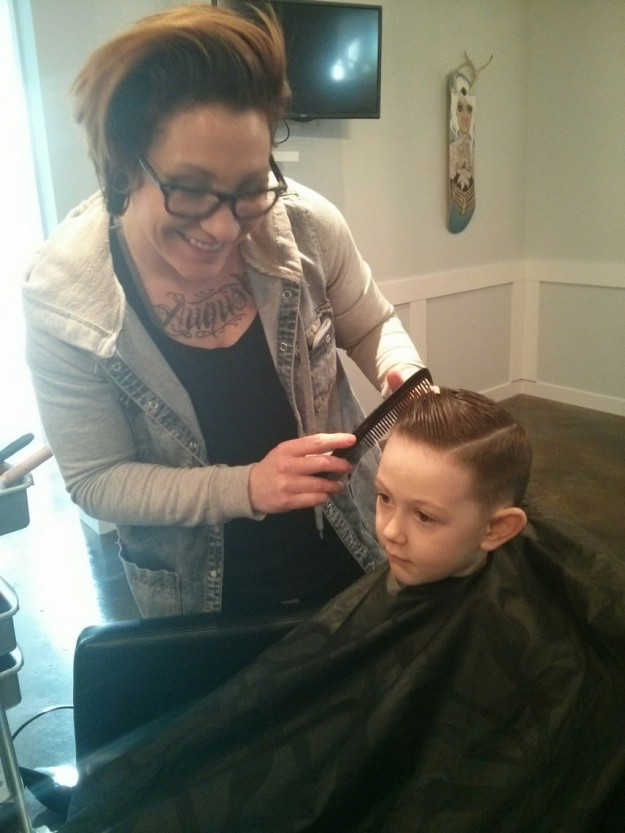 Jackson getting his haircut. New wainscoting chair rail in the background.