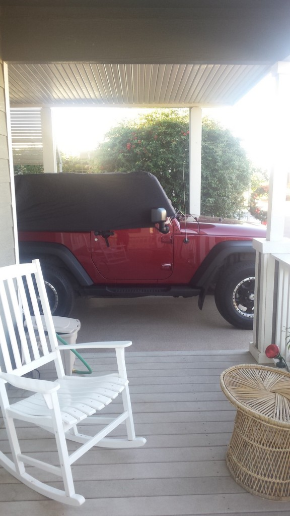 Jeep all waxed up. UV protection on all the fenders and all covered up.